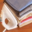 Ironing and clothes piled — Stock Photo #3037750