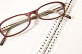 Notebook and glasses — Stock Photo