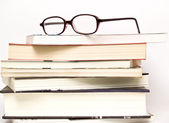 Eyeglasses on book — Stock Photo