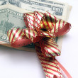 Dollars with bow — Stock Photo