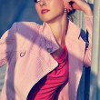 The girl in a pink coat - Stock Photo