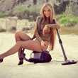 The girl with a vacuum cleaner - Stock Photo