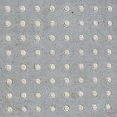 64 white cement buttons — Stock Photo