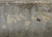 Dirty gray wall with spurs and cracks — Stock Photo