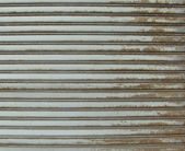 Rusty metal store role shutter — Stock Photo
