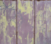 Purple metal fence with rust and — Stock Photo