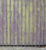 Purple metal fence with rust — Stock Photo