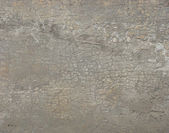 Heavily cracked dirty gray beige wall — Stock Photo
