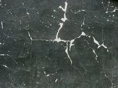 White on black peeling cracked paint — Stock Photo