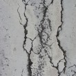 Split black crack pattern on light gray - Stock Photo