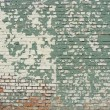 Damaged worn green white painted brick wall — Stock Photo