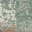 Damaged worn green white painted brick wall - Stock Photo
