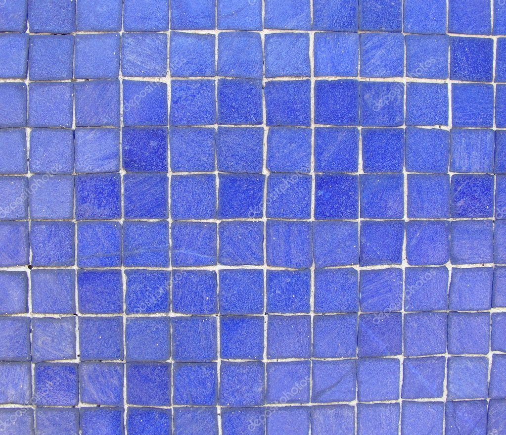 Wall with bright blue mosaic tiles stock photo Bright blue tile