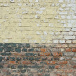 Damaged worn brick wall — Stock Photo