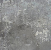 Worn gray wall with peeling blue damaged paint — Stockfoto