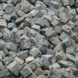 Stock Photo: Large stack mountain of cobble stone