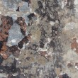 Dirty worn white gray wall with remains of orange black blue — Stock Photo #3329344