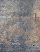 Flamed color dirty worn concrete wall with cracks and rubber mar — Stock Photo