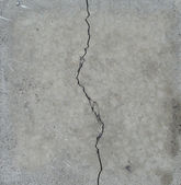 Elegant split crack in gray stone — Stock Photo