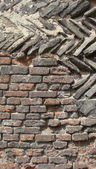 Section of a medieval wall with diagonal stone and brick — Stock Photo