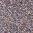 Concrete with gray purple pink brown stone pebbles wall - 