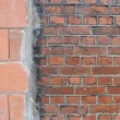 Transition from large to small red brick repair — Stock Photo #3464892