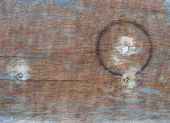 Circular burn mark on worn wood with leftovers from paint — Stock Photo