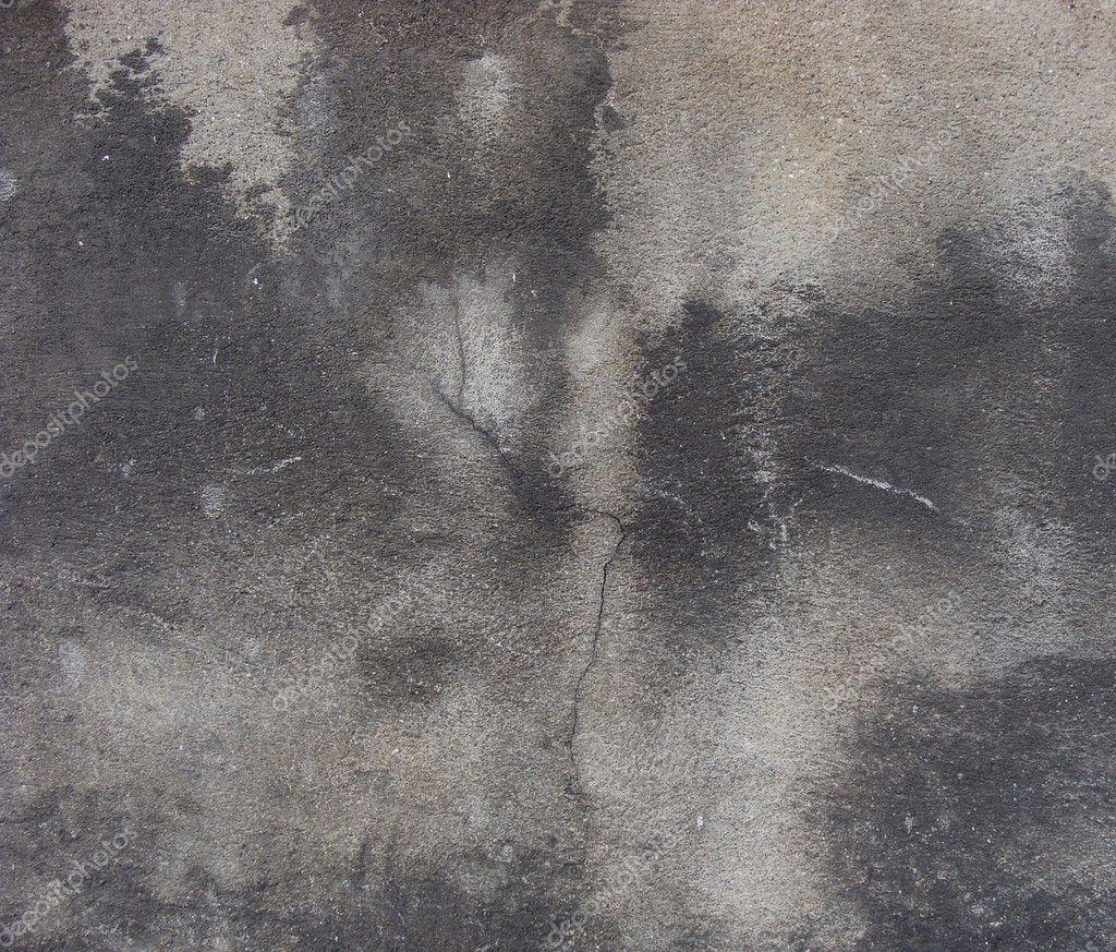 Grau beige abgenutzte wand mit schwarze wolke von schmutz ...