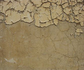 Dirty beige brown wall with some peeling blathering paint at the — Photo