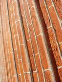 Red orange brown unusual brick pattern — Stock Photo