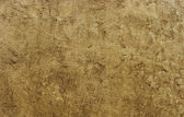 Worn old dirty beige brown stone wall — 图库照片