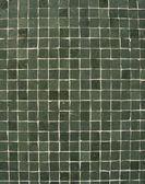 Dark green tiles mosaic pattern on a wall — Стоковое фото