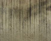 Worn striped raked concrete with some dirt — Stock Photo