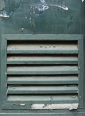 Green metal grunge door with ventilation grid shaft — Stock Photo