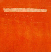 Beige white stroke on a worn orange surface — Stock Photo