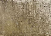 Brown gray beige dirty worn wall with peeling paint — Stock Photo
