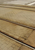 View of a rusty tramway and road with zebra path — Stock Photo