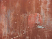 Worn painted red metal surface with scratches and dirt — Stock Photo