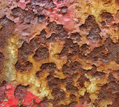 Orange brown red rusty metal surface with spraypaint mark — Stock Photo