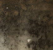 Very dark brown black grunge on a gray stone cut wall — Foto de Stock