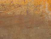 Orange painted metal with rust and scratches — Stock Photo