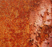 Very rusty plate of red metal — Stock Photo