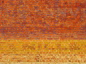 Bright colored brick wall with yellow orange and purple — Stock Photo