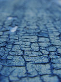 Close view of blue crackled paint — Stockfoto