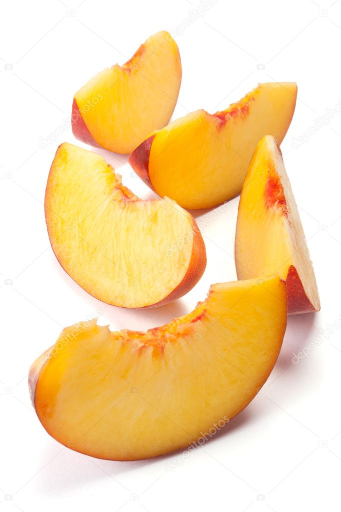 Sliced peaches isolated on a white  Stock Photo #3652153