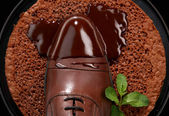 Mans shoes in chocolate on a plate — Stock Photo