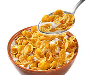 Bowl with dry corn flakes — Stock Photo