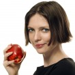 Beautifull brunette taking an apple — Stock Photo