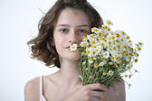 Beautyfull teenage girl with camomiles - Closeup portrait — Stock Photo