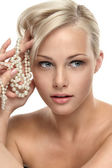 Beautiful blonde girl with Pearl beads — Stock Photo